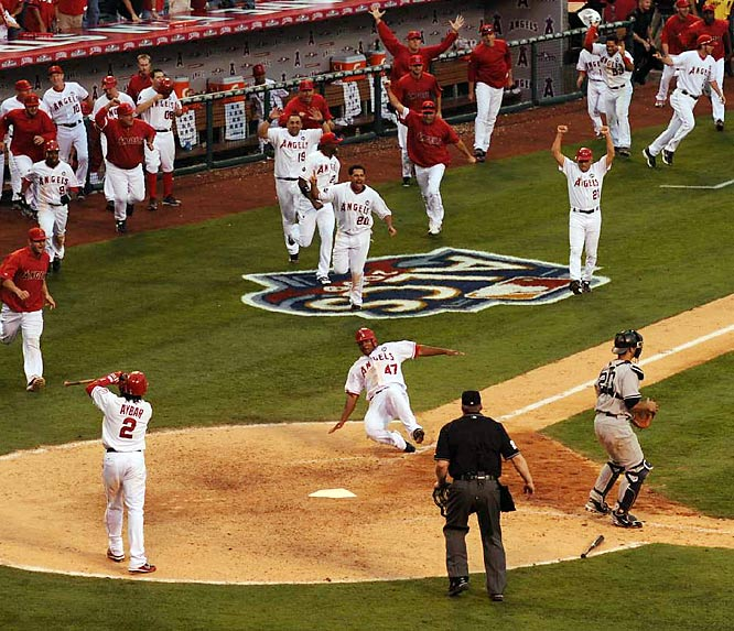 The Angels celebrate Howie Kendrick's winning run as they closed the gap on the Yankees in the best-of-seven series.