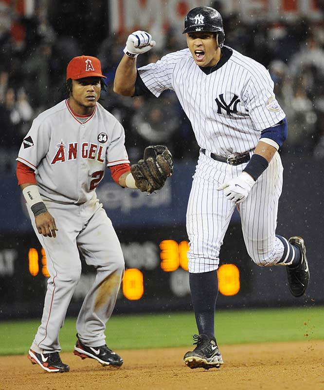 Alex Rodriguez celebrates his game-tying homer in the 11th.