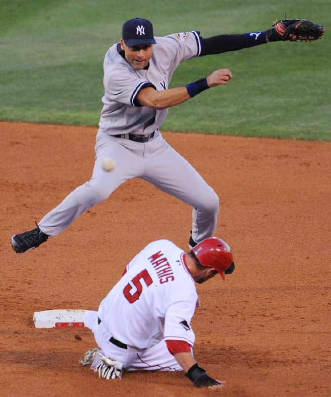 Derek Jeter turns a double play in the second inning over Jeff Mathis.