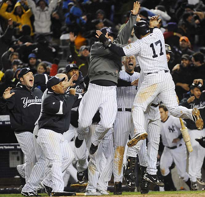 The Yankees celebrate their walk-off win in the 13th inning.