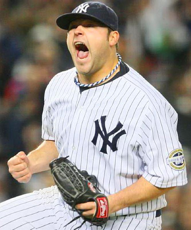 Joba Chamberlain struck out Vladimir Guerrero with the bases loaded in the seventh.