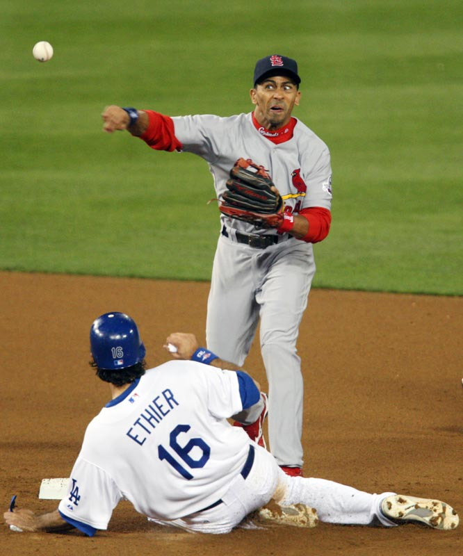 St. Louis Cardinals second baseman Julio Lugo turns a double play, forcing out Dodgers right fielder Andre Ethier in the seventh inning at Dodger Stadium.