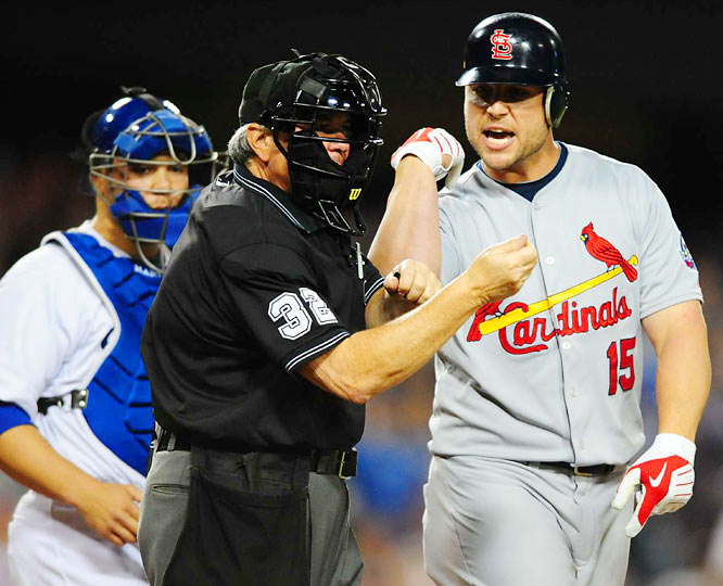 Cardinals left fielder Matt Holliday argues that he was hit by a pitch with home plate umpire Dana DeMuth in the 4th inning.