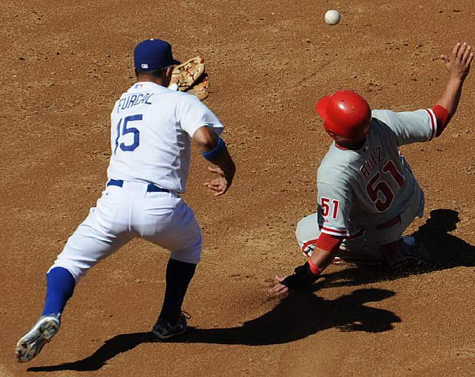 Carlos Ruiz steals second base as the ball gets away from Rafael Furcal in the third inning.