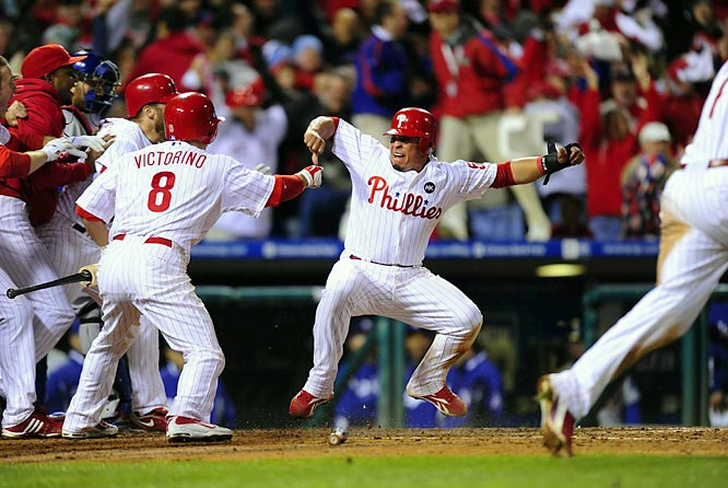 Carlos Ruiz celebrates as he scores the game-winning run.