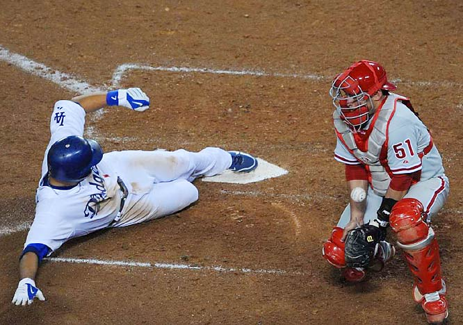 James Loney scores past catcher Carlos Ruiz in the eighth inning. Loney was driven in by Rusell Martin's single.