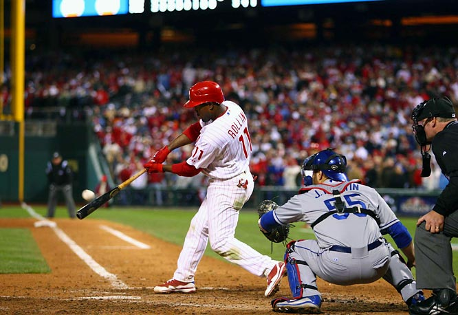Jimmy Rollins lines a two-run double with two outs in the bottom of the ninth inning off All-Star closer Jonathan Broxton for the win.