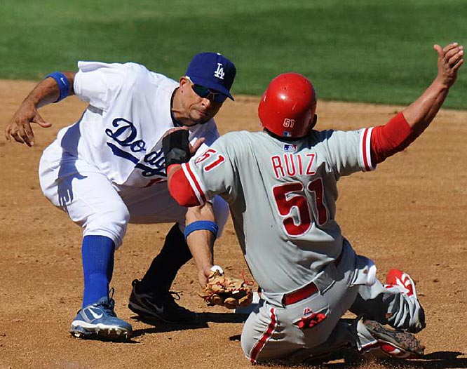 Rafael Furcal tags out Carlos Ruiz at second base in the eighth inning.