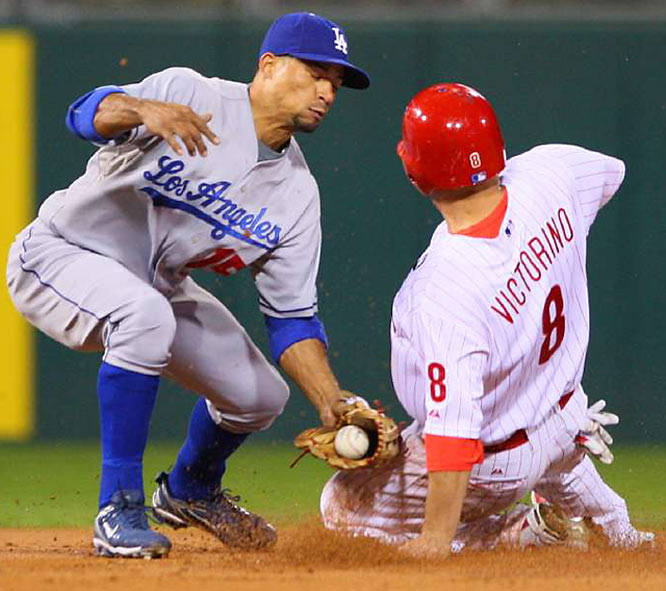 Shane Victorino steals second under the tag of Rafael Furcal in the first inning.