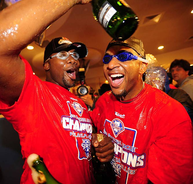 Ryan Howard and teammates celebrated advancing to the World Series.
