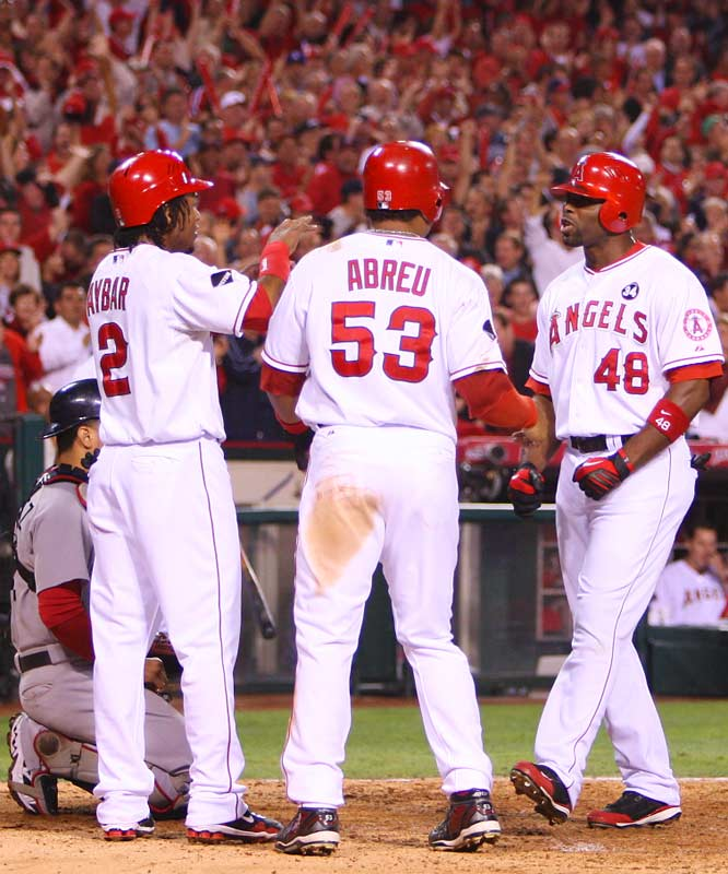 Torii Hunter celebrates with teammates Bobby Abreu and Erick Aybar after his home run.