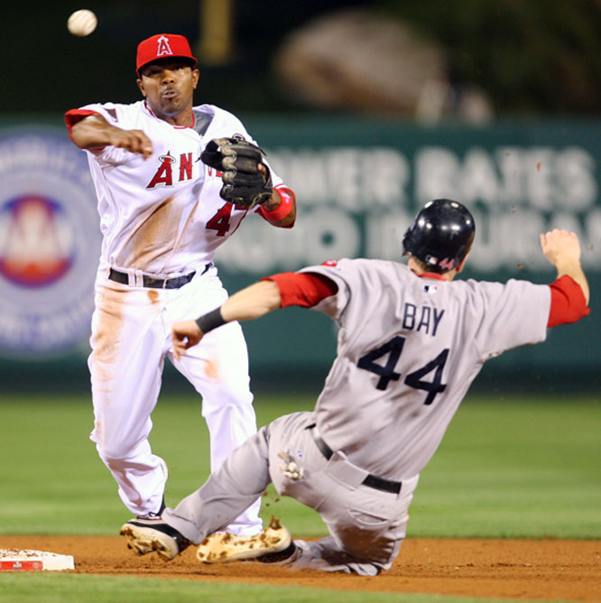 Howie Kendrick turns a double play as Jason Bay is out sliding into second base in the fifth inning.