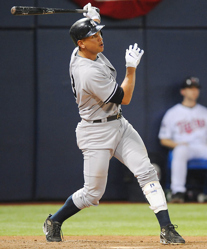 Alex Rodriguez follows the flight of his solo homer in the seventh.