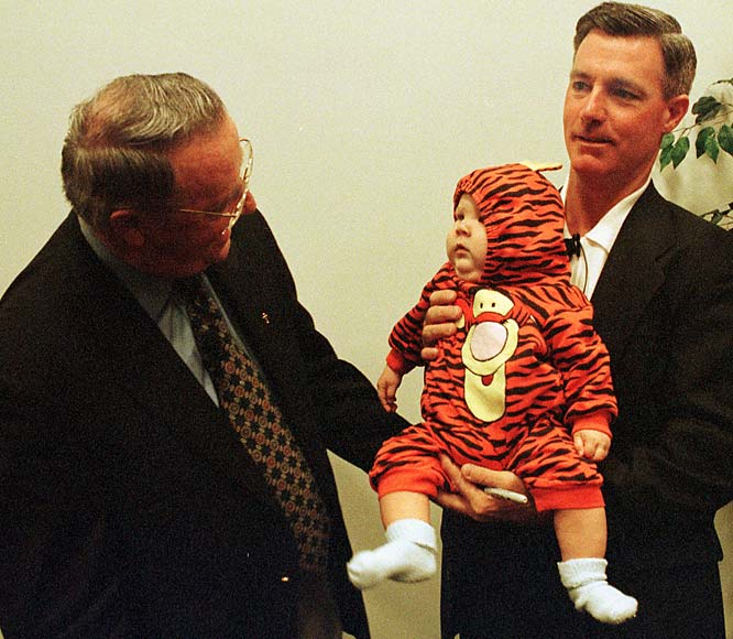 Bobby Bowden says hello to five-month-old Noah Horton as Tommy Bowden holds the young tiger.