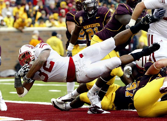 John Clay rushed for three touchdowns and gained 159 of his 184 yards in the second half, helping Wisconsin beat the Gophers for the sixth straight time. The victors picking up Paul Bunyan's Axe and paraded it around the stadium after Adam Weber lost a fumble at his own 24 with 30 seconds left to kill Minnesota's last-chance drive of overcoming a 31-28 deficit.Don't confuse the Michigan-Michigan State battle for the Paul Bunyan Trophy with the Wisconsin-Minnesota battle for the Paul Bunyan Axe. This year the storied rivalry, which dates back to 1890, christens Minnesota's palatial new TCF Bank Stadium.