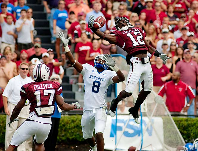 C.C. Whitlock breaks up a pass during a narrow victory over Kentucky that wasn't secured until defensive end Cliff Matthews knocked down a potential tying two-point conversion pass in the closing minutes. The win gave South Carolina a 5-1 record heading into its weekend showdown against undefeated Alabama.