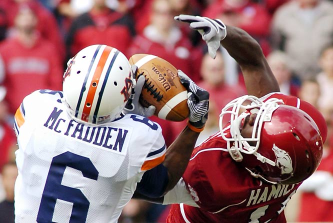 Auburn cornerback Walter McFadden makes an interception over Cobi Hamilton on a day when very little else went the Tigers way. Arkansas led 27-3 at the half and held off a late challenge to hand Auburn its first loss.