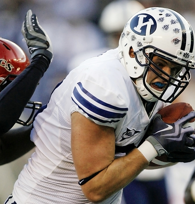 Andrew George hauls in a 19-yard scoring pass to increase BYU's lead. George caught four passes for 95 yards and a touchdown for the Cougars, who defeated the Aztecs for the eighth time in the last nine games.