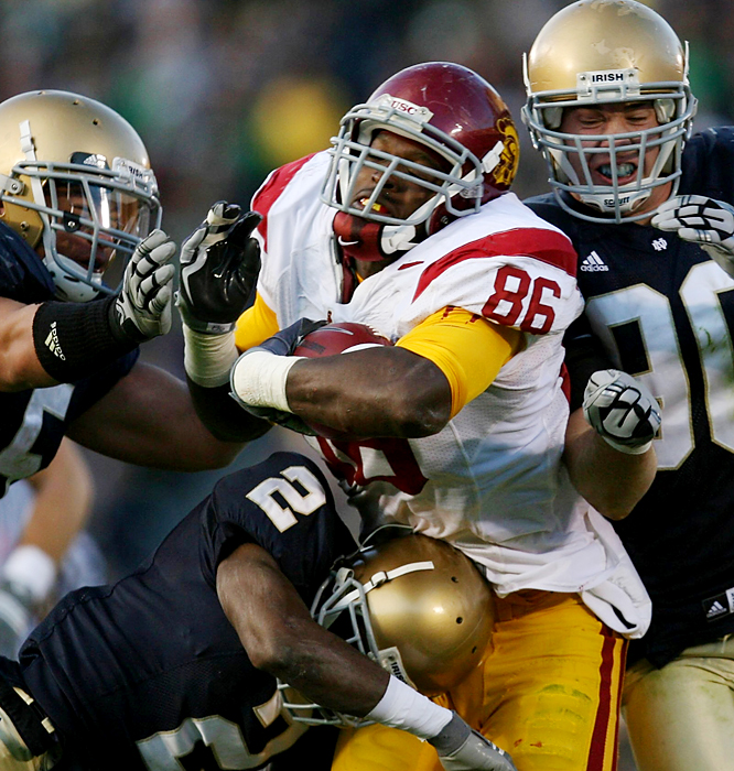 USC's Anthony McCoy (center) breaks into the Notre Dame secondary. The tight end caught five passes for 153 yards -- Damian Williams added 108 receving yards -- as the Trojans notched their eighth straight win over the Irish, which trailed 34-14 before rallying in the fourth quarter.