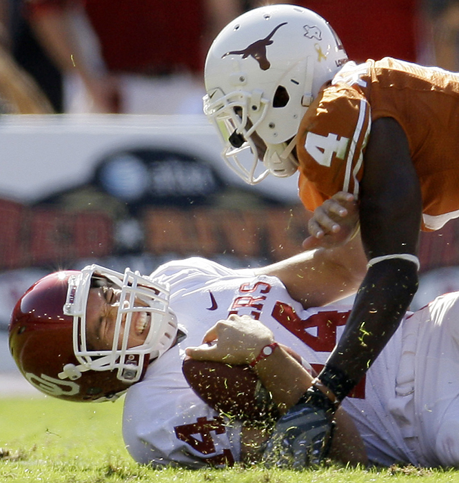 Oklahoma quarterback Sam Bradford reacts after being sacked by Texas cornerback Aaron Williams in the first half. Bradford, who didn't return to the game, reinjured the sprained shoulder he first hurt against BYU in the opener. The 104th edition of the Red River Rivalry was one of the ugliest, with the teams combining for eight turnovers and only a single touchdown. Hunter Lawrence's early fourth quarter, 32-yard field goal was the difference.