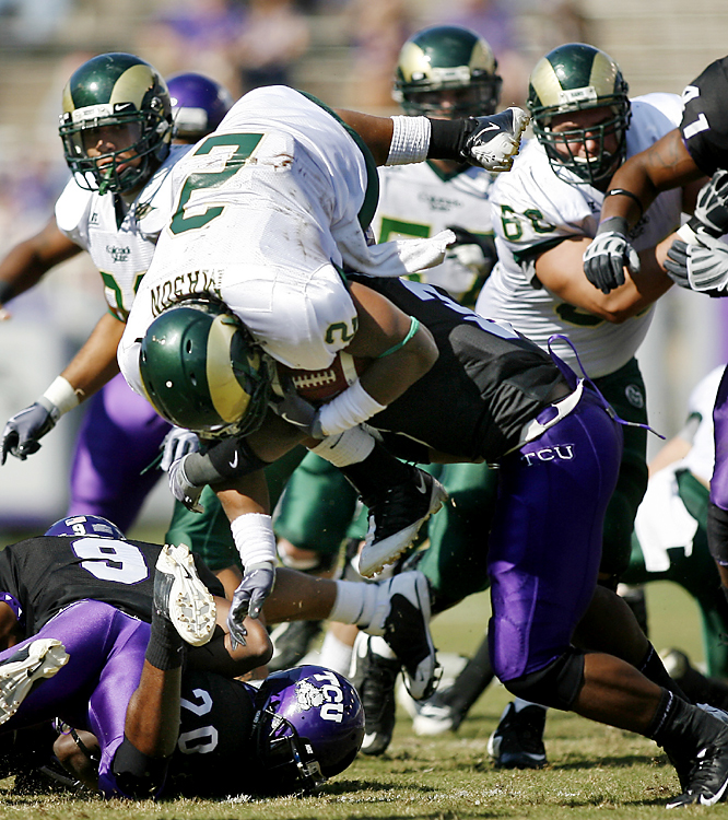 TCU's Tejay Johnson (right) sticks Colorado State running back DeAngelo Wilkinson. The Horned Frogs (6-0) held the Rams to 71 rushing yards. They took control in the second half, scoring touchdowns on their first four drives after halftime.