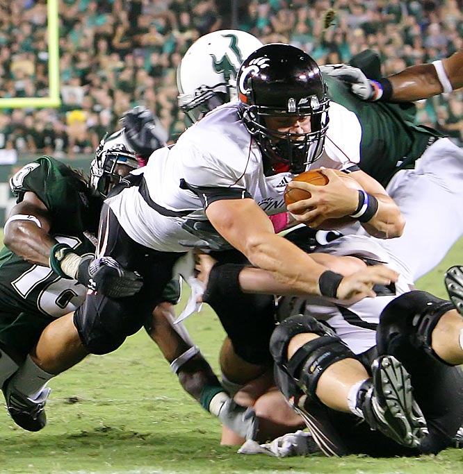 Quaterback Zach Collaros (right) came off the bench to rush for 132 yards and two touchdowns to lead the Bearcats in a matchup of Top 25 teams. Collaros, who entered the game after starter Tony Pike sprained his left wrist, rushed for a 75-yard touchdown three plays after entering the game.