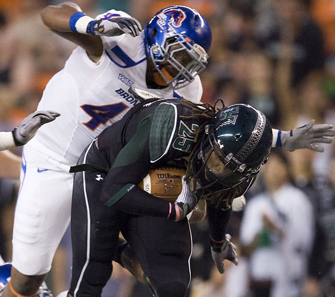 Hawaii running back Alex Green is brought down by the Boise State defense during the second quarter. The No. 6 Broncos built a 34-0 halftime lead and cruised to their seventh victory of the season.