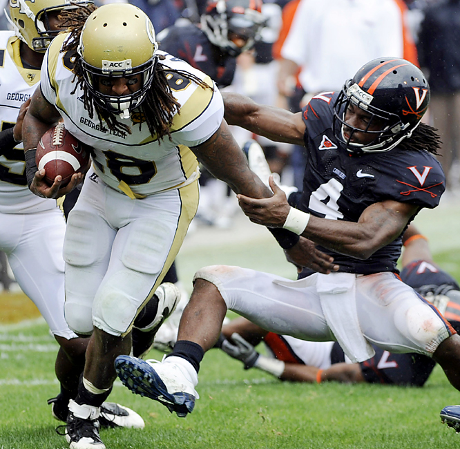 Georgia Tech's Anthony Allen (left) barrels his way into the Virginia secondary. Allen rushed for 103 yards and two touchdowns for the Yellow Jackets, who scored on an 18-play, 82-yard drive which took 10:47 off the second-half clock. Georgia Tech also broke an eight-game losing streak in Charlottesville.