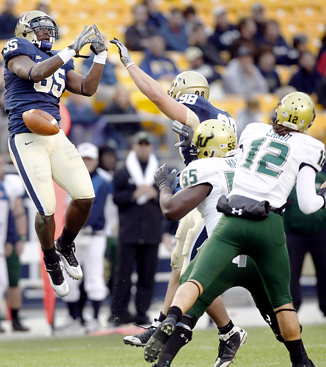 Pittsburgh's Brandon Lindsey (left) makes his presence felt by knocking down an Evan Landi pass. The Panthers limited the Bulls to seven completions for 90 yards and scored on five first-half possessions to improve to 7-1 for the first time since 1982 -- Dan Marino's senior season and the last time Pitt was ranked No. 1.