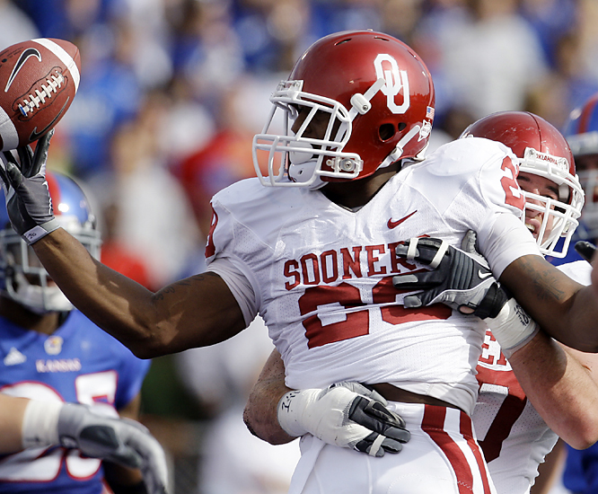 Oklahoma's Chris Brown celebrates one of his three touchdowns (two rushing, one receiving). The Sooner defense limited Kansas -- the  nation's second-leading offense -- to two field goals until late into the fourth quarter.