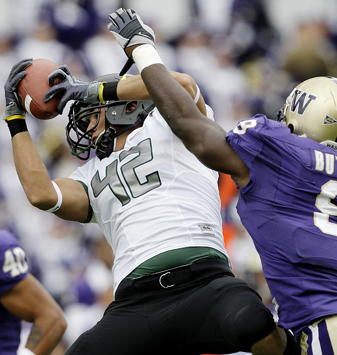 David Paulson (left) hangs on to complete a 32-yard play for Oregon, which took a 36-6 lead into the fourth quarter. LaMichael James rushed for 154 yards and two touchdowns and Jeremiah Masoli returned from a knee injury to run for two scores as Oregon extended its dominance of Washington to six straight -- longest in the history of the series. Each win has been by more than 20 points.