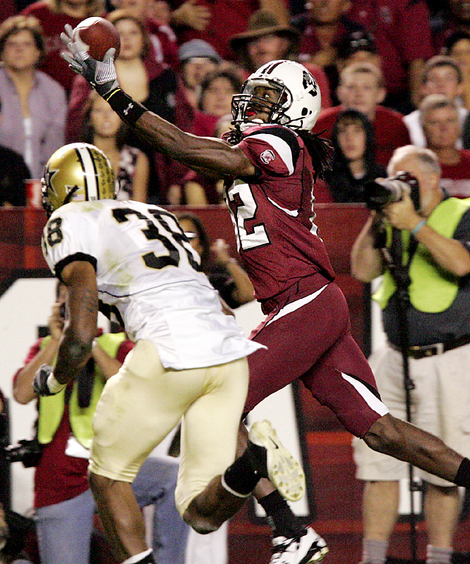 South Carolina's D.L. Moore (right) keeps his eye on the ball while hauling in a 35-yard touchdown pass from Stephen Garcia at Williams-Brice Stadium. Garcia threw for 302 yards and two touchdowns as the Gamecocks handed the Commodores their sixth straight conference loss.
