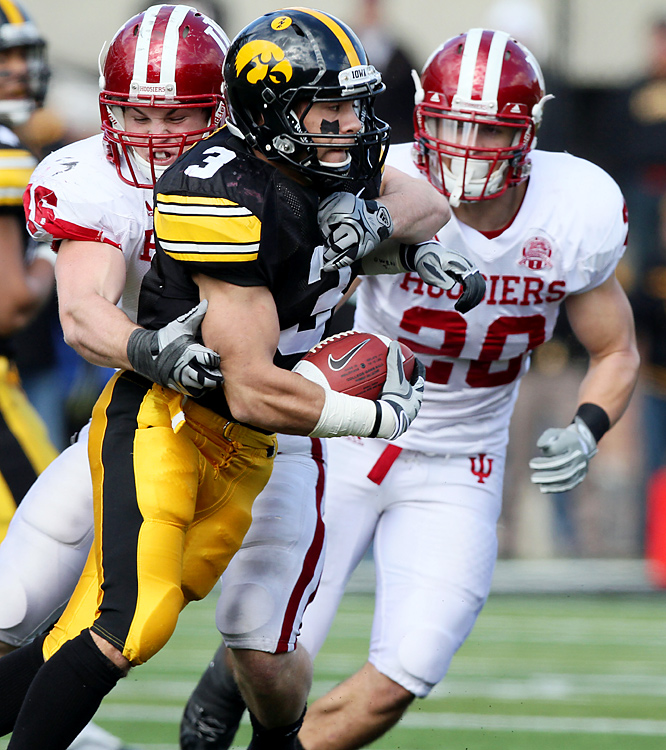 Brandon Wegher rushed for a career-high 118 yards and three TDs, including two in a 28-point fourth quarter, as Iowa rallied from a 21-7 deficit. After needing two blocked field goals to beat FCS school Northern Iowa in its opener, Iowa is off to the best start in school history, thanks to four wins by three points or less.
