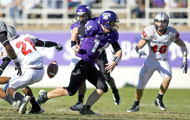 Andy Dalton fumbled here, but he still threw for 178 yards and three touchdowns as TCU had no trouble with UNLV. The unbeaten Horned Frogs remian in the hunt for a BCS berth.