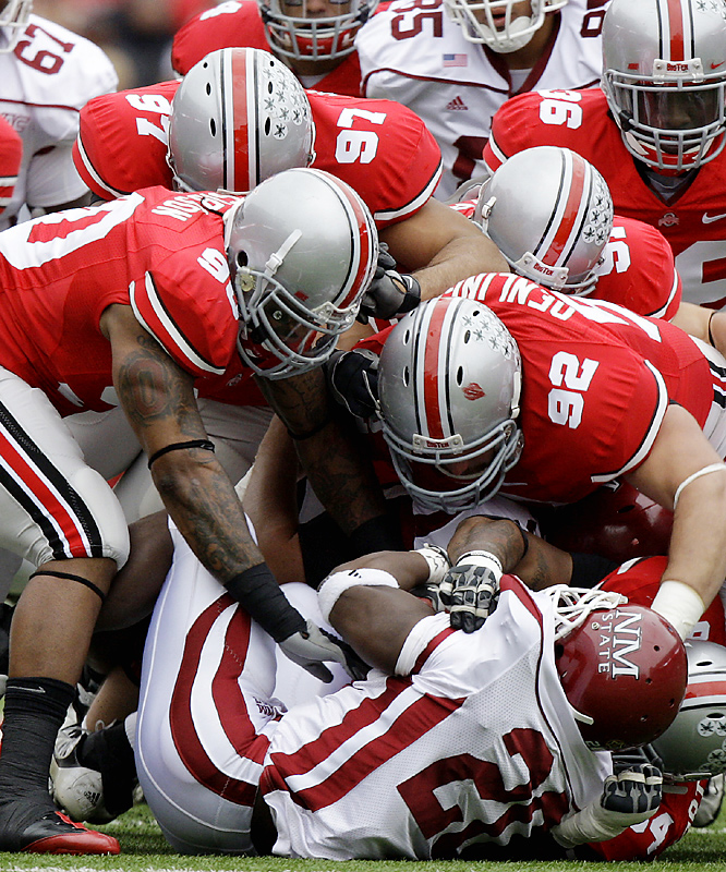 The Buckeye defense throttled the overmatched Aggies, last among all Bowl Subdivision teams in total offense, by allowing just 62 yards -- and two first downs. Terrelle Pryor threw for one touchdown and ran for another as Ohio State improved to 7-2.