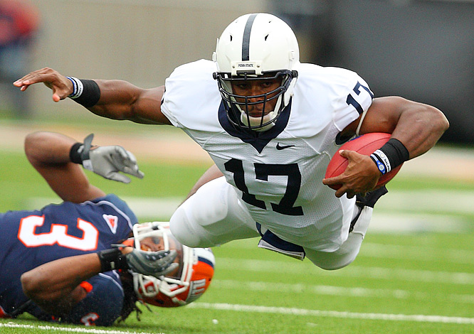 Quarterback Daryll Clark of Penn State dives for yardage after being tripped up by cornerback Tavon Wilson of Illinois.