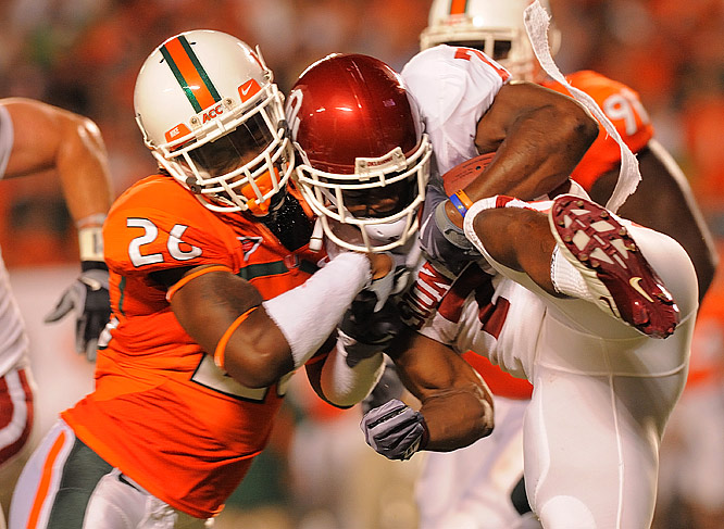 Ray Ray Armstrong (26) tackles DeMarco Murray during Miami's win over the Sooners.