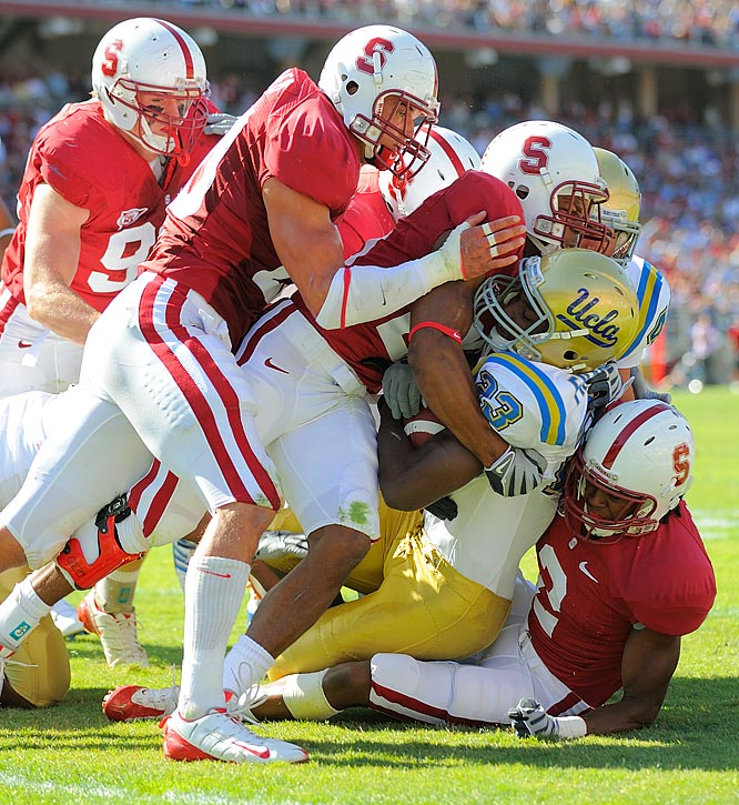Johnathan Franklin gets tackled by the Stanford defense.