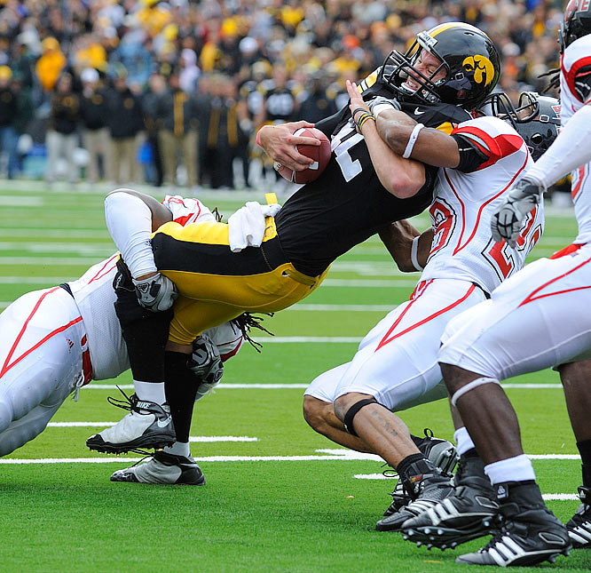Iowa's Ricky Stanzi gets tied up by Arkansas State defenders.