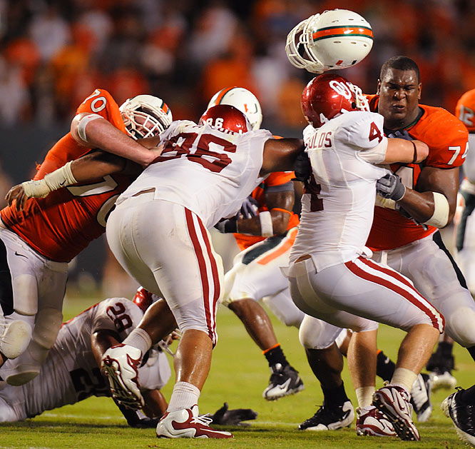 Miami's Orlando Franklin loses helmet while making a tackle.