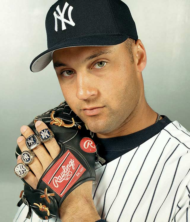 Derek Jeter poses with his four World Series Championship rings in 2001.<br><br><i>Left to right:</i><br>1999 World Series, Yankees over Braves 4-0<br>1998 World Series, Yankees over Padres 4-0<br>2000 World Series, Yankees over Mets 4-1<br>1996 World Series, Yankees over Braves 4-2