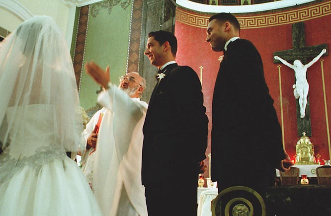 Jeter serves as best man for his longtime teammate Jorge Posada's wedding in January, 2000.