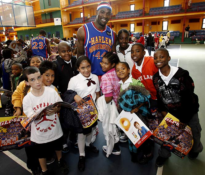 The New York City Police Athletic League helped sponsor the event, much to the delight of thousands of elementary school kids in Harlem.
