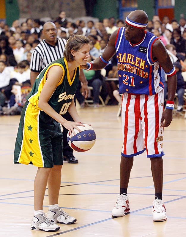 """Playing against the Globetrotters was truly a """"hands-on"""" experience for Blackmar, who hit one of two foul shots despite a little interference from Special K Daley."""