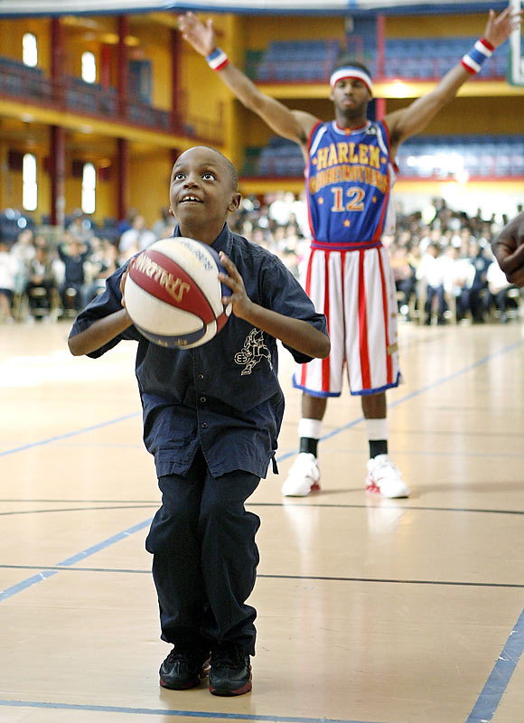 Smiles abounded in the audience as many young fans were invited to participate in the show. Here Globetrotter Ant Atkinson cheers on 10-year-old Xavier Hall from C.S. 200.