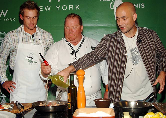 Andy Roddick, chef Mario Batali and Andre Agassi cook at a party at the W Hotel in New York City.