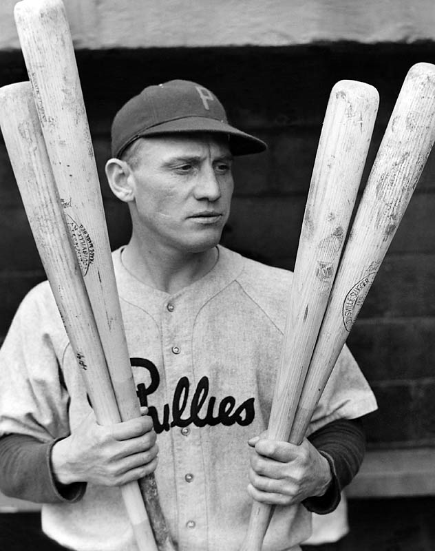 Chuck Klein, one of the top sluggers of the late 1920s and '30s, inspects his bats.