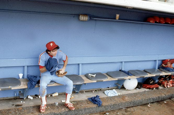 Shortstop Larry Bowa sits alone in the dugout after the Phillies lost a season-ending Game 4 of the NLCS to the Dodgers.