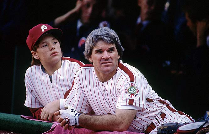 Pete Rose and son, Pete Rose Jr., enjoy the view from the Phillies dugout.