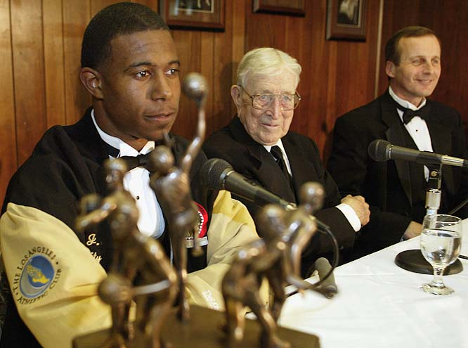 The Wooden Award, presented annually to the outstanding collegiate basketball Player of the Year, was founded in 1976. In this photo, then-Texas sophomore point guard T. J. Ford listens to Wooden after receiving the honor.